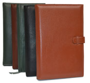 black, tan, camel and green leather planners